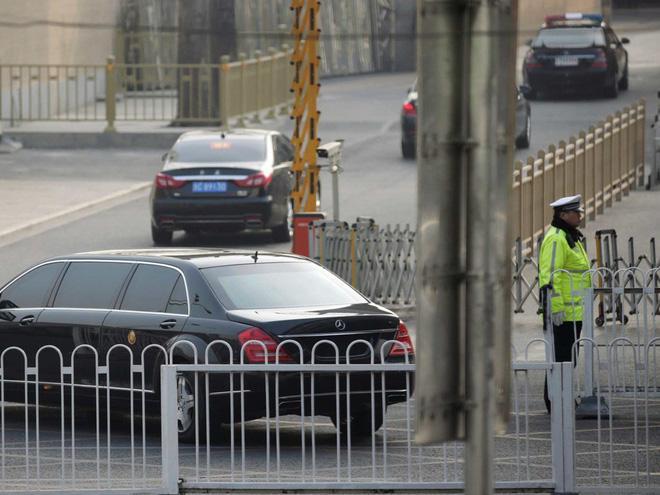 Tại sao nhà lãnh đạo Triều Tiên Kim Jong-un mặc áo khoác đen, đội mũ đen khi đến Bắc Kinh? - Ảnh 7.