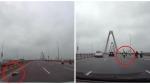 CLIP: Người phụ nữ nằm trong làn 90km/h rồi đứng lên múa giữa cầu Nhật Tân khiến bao người khiếp sợ