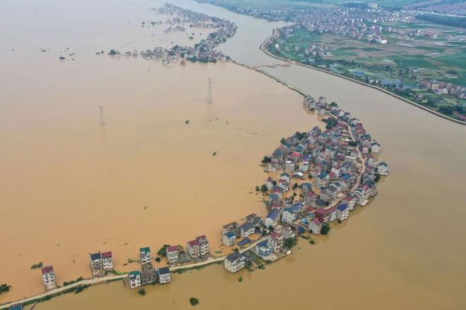 Mưa lũ lịch sử gây ngập lụt ở tỉnh Giang Tây, Trung Quốc ngày 13/7 (Nguồn ảnh: AFP)