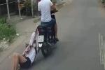 [Clip] Kẻ cướp kéo lê cô gái hàng chục mét trên đường phố Sài Gòn