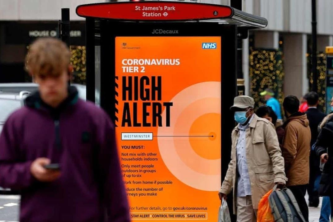 Chính phủ Anh ngày 19/12 đã đưa ra nhiều biện pháp chống dịch nghiêm ngặt vì biến chủng mới của virus corona. Ảnh: AFP.
